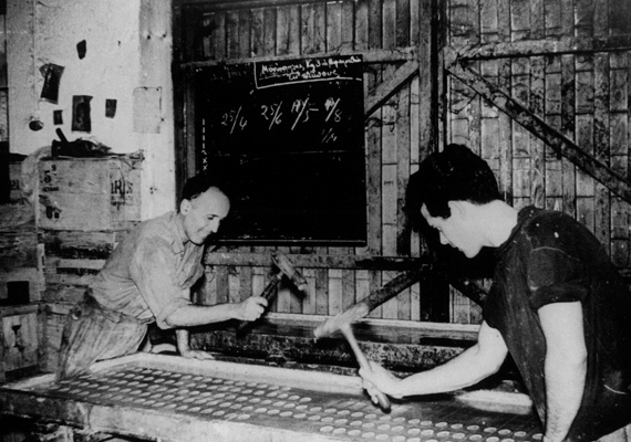 Old photo of workers stamping soap